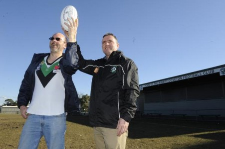 Steve Moloney and Shane Viney hold aloft the white footy that will be used at this Saturday's inaugural White Ribbon footy match between Doveton and Pakenham. 124635 Picture: STEWART CHAMBERS
