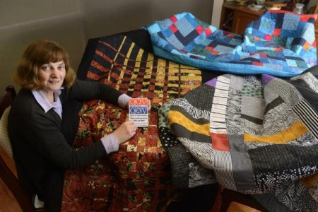 Helen Comport, here with several handmade quilts, was inspired to start up Quilts of Valour Australia after her son was injured in conflict in Afghanistan. 127533_01 Picture: ROB CAREW