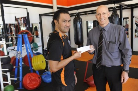 Head boxing coach Rob Auimatagi with Detective Sergeant Chris Lewis. Det Sgt Lewis presented the Casey Youth Fitness Program with a $300 cheque on behal