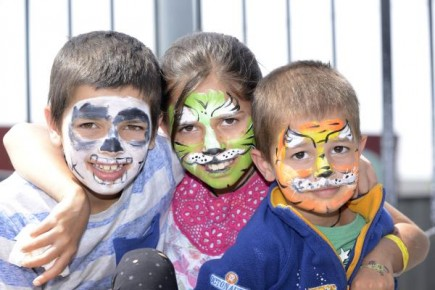 Crowds flocked to the Cranbourne Racecourse last weekend for a family fun day out. With their facepaint brothers and sister from left, nine-year-old Raman, 10-year-old Jasminder and three-year-old Jaivin. 128980  Pictures: ROB CAREW