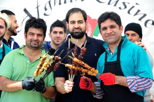 """From left, Rishad Fazal, Munir Lodin and Khushal Taniwal selling Kebabs to raise fund for the """"Omar Farooq Mosque"""" in Doveton. 108347_08"""