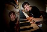 Connor Raselli tapping out a tune on the piano at his Berwick home. 147730 Picture: GARY SISSONS