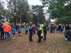 Police hold a discussion in a reserve, after Berwick Chase students were evacuated last month.